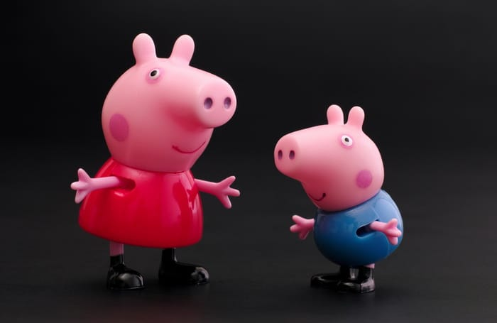 Tambov, Russian Federation - December 16, 2015 Peppa Pig and George Pig toy characters on black background. Studio shot.