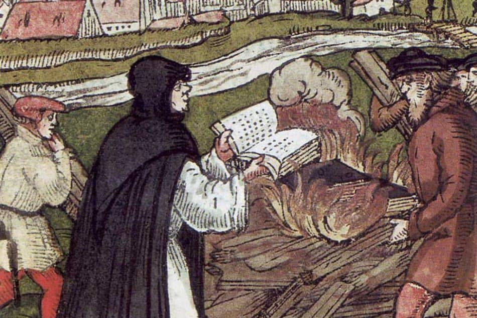 Мартин Лютер сжигает папскую булу (гравюра 1500-х годов)